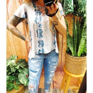 Trendy snakeskin ruffled lace up babydoll top 🌜